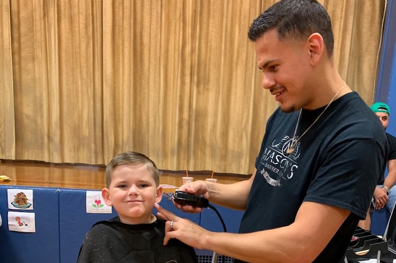 Free haircuts provided before start of school in Newark